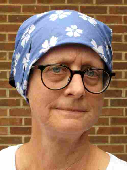 Katherine Troyer, 54, is undergoing chemotherapy for stage IV metastatic breast cancer.  Troyer has good health coverage now, but her employer just went through a merger and expects to shed staff in the fall.  If Troyer loses her job, she'll lose her health insurance.