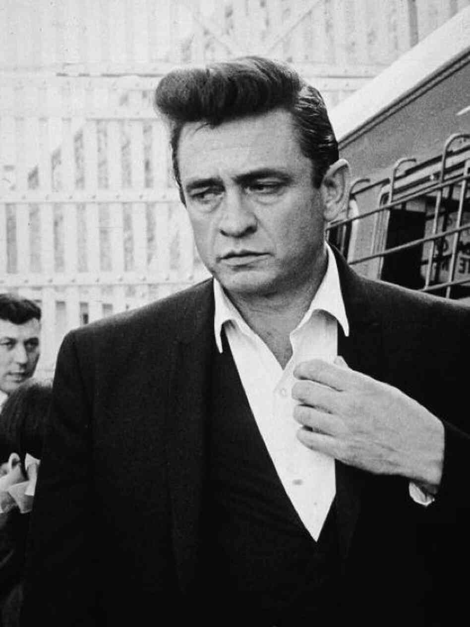 American country singer and songwriter Johnny Cash (1932-2003) walks inside Folsom on his way to perform for inmates there in 1964.