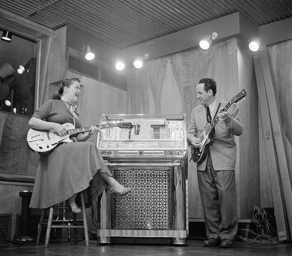 Paul and his wife, Mary Ford, practice in their Oakland, N.J., home on Dec. 20, 1953. The duo earned 36 gold records and 11 No. 1 pop hits from 1949 to 1962.
