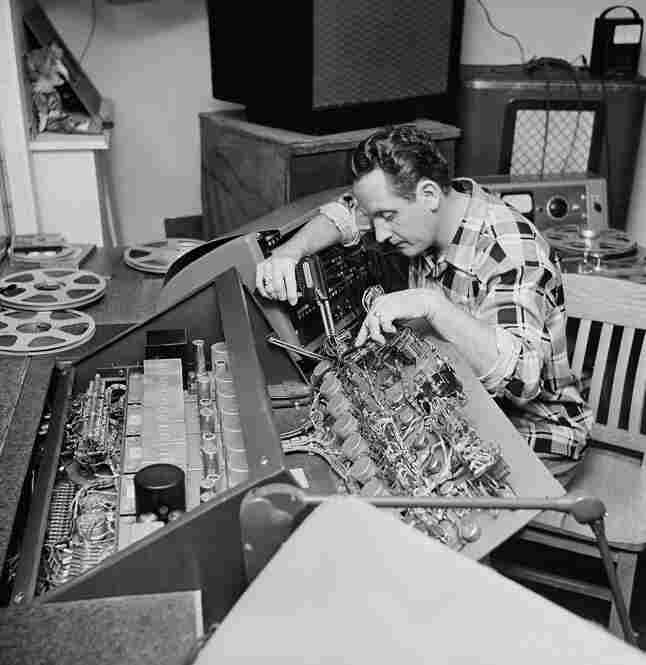 Paul repairs one of the many control boards in his New Jersey home on Dec. 20, 1953. He popularized the use of multitrack recording, which has influenced many recording artists since.