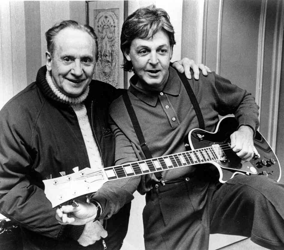 "Former Beatle Paul McCartney tries out a custom-made left-handed ""Les Paul Lite"" guitar presented by Paul himself, in New York City on May 1, 1988. Gibson Guitars began producing the Les Paul guitar in 1952."