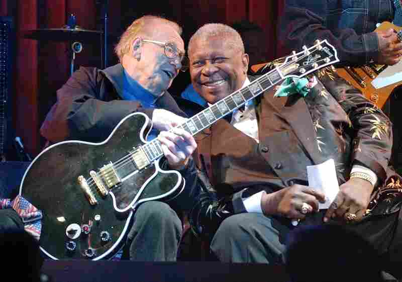 "Paul and blues guitarist B.B. King put their heads together during a jam session at the third anniversary celebration of the B.B. King Blues Club and Grill in New York's Times Square, June 17, 2003. Paul holds King's signature guitar, ""Lucille,""  which he played."