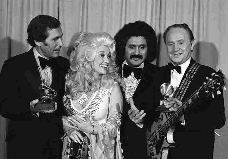 Paul and Chet Atkins (left) are presented Grammies by Dolly Parton and Freddie Fender at 19th annual Grammy Awards in Los Angeles on Feb. 19, 1977. Paul continued to win awards for his music well into the later years of his life. He was in the hospital in February 2006 when he learned he had won two Grammys for an album released after his 90th birthday, Les Paul & Friends: American Made, Wor...
