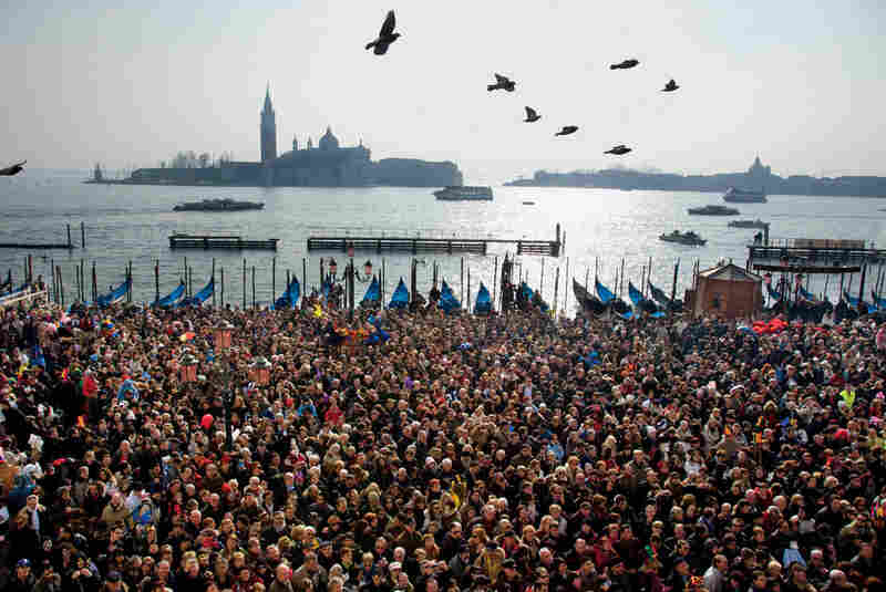 Thirty years ago, the population of Venice was about 120,000. Today fewer than 60,000 people live there. But the tide of tourism makes up for a diminishing population. Tourist numbers peak at Carnival, when crowds gather around and near the Piazzetta San Marco.