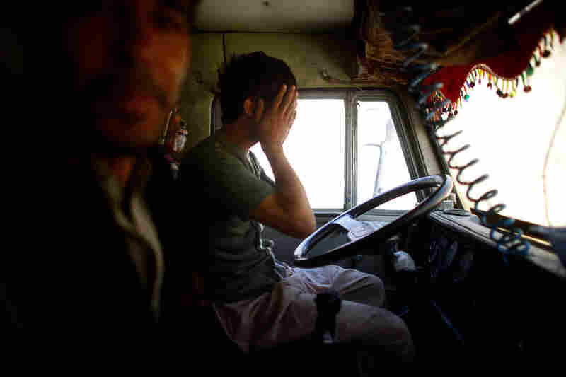 A truck driver wipes his eyes after driving all night to deliver voting materials in the Yangam district of Badakhshan province. The terrain is so treacherous and roads are so poor that it can take up to 24 hours to travel 30 miles. Yangam has become especially difficult to reach this year after winter floods.