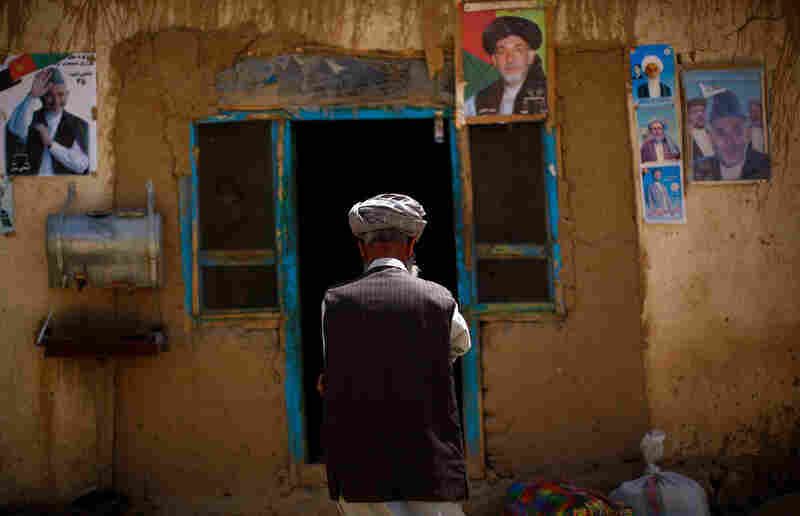Posters of Afghan President Hamid Karzai are taped to the side of the only restaurant in Yangam district. In this Tajik-dominated ethnic region of Afghanistan, politics take center stage as the presidential election draws near.