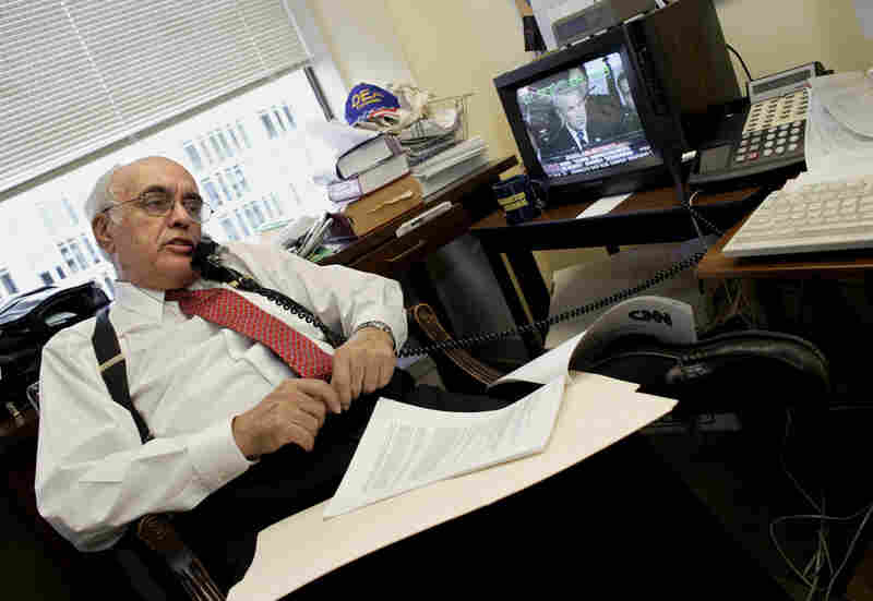 Novak sits in his Washington, D.C., office in October 2003, four months after publishing the article that disclosed that Valerie Plame, wife of former Ambassador Joseph C. Wilson, was a CIA operative specializing in weapons of mass destruction.