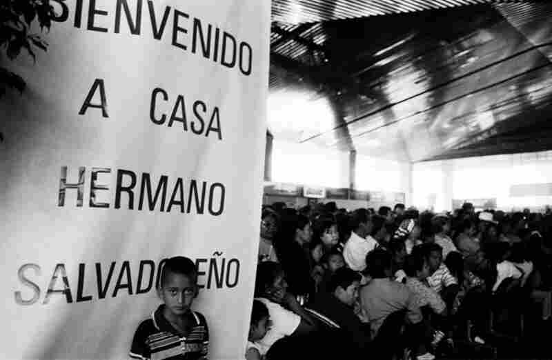 People wait at the Comalapa International Airport to greet visiting Salvadorans. Tens of thousands of Salvadorans fled the country during and after the war to seek better lives elsewhere, mainly in the United States.