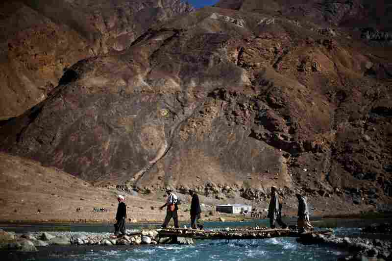 Men walk to vote Thursday in Iskazar, in the Kuran wa Munjan district of Badakhshan province in northern Afghanistan. More than 300 mainly ethnic Tajiks cast their votes in the presidential election in this village in the Hindu Kush mountains.