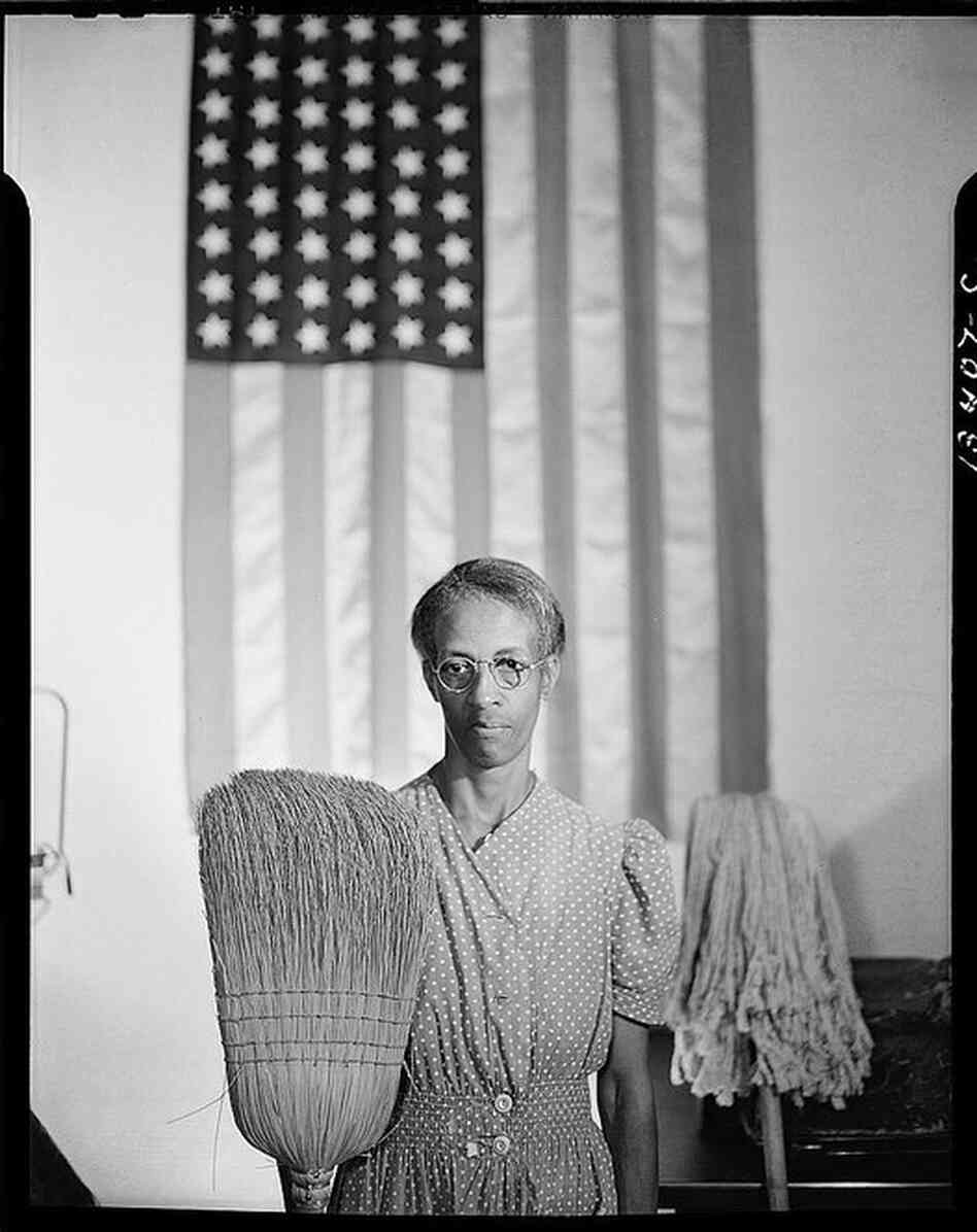 Commonly known as American Gothic, this photo of charwoman Ella Watson was taken in Washington, D.C., in 1942.