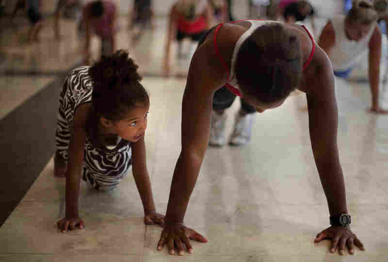 Stephanie Maurer of Silver Spring, Md., attends the workout class with her daughter Riley.