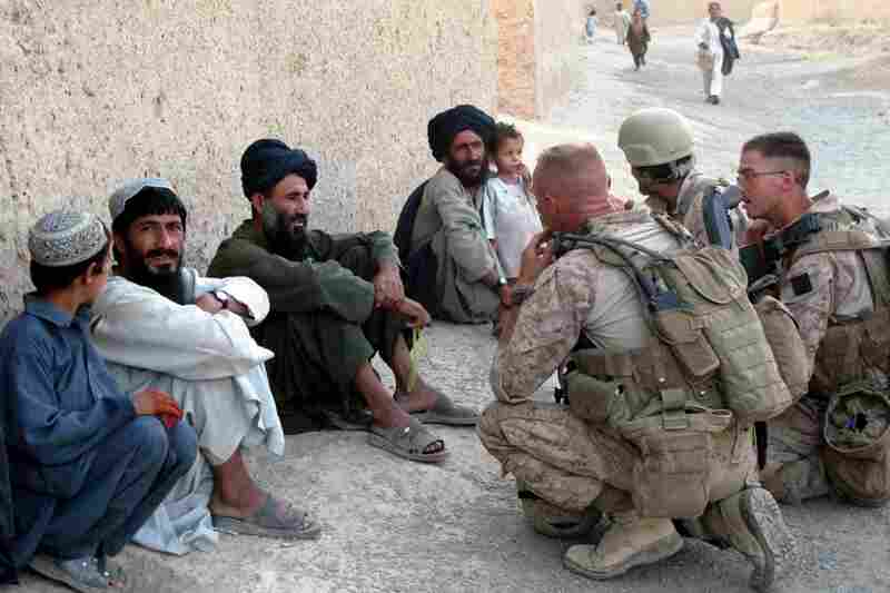 Marine Staff Sgt. Todd Bowers (center) talks with residents of Khawji Jamal. Bowers, who heads a civil affairs team, is part of the new strategy to win the support of villagers.