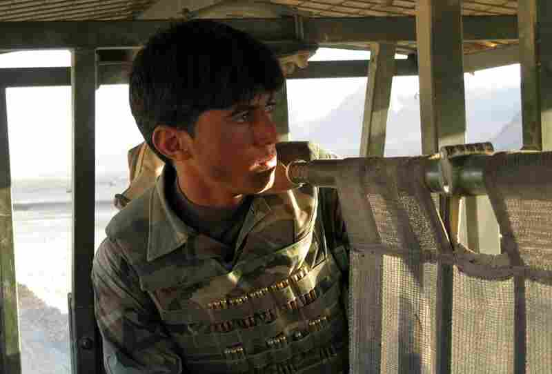 An Afghan soldier looks out of a Marine truck as a battle begins to clear the Taliban out of the Now Zad village of Dahaneh. Some Afghan soldiers came with the Marines on the mission, but the Afghans ended up contributing little.