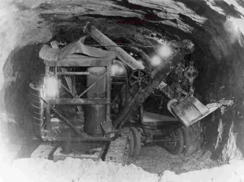 An Erie Air Shovel scrapes away rock to widen Zion Tunnel in the late 1920s.  When completed in 1930, the tunnel was the longest in the U.S. Credit: William Crawford