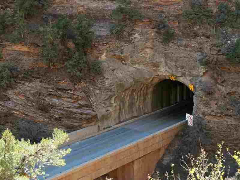 This image shows the east entrance of the Zion Tunnel in 2007. The entrance is so narrow that today's RVs require ranger escorts and the closure of the opposite lane to traffic. Credit: Nick Jorgensen