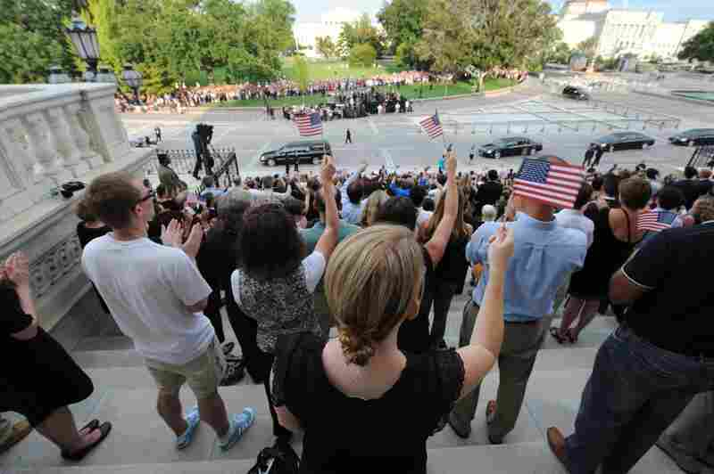 People gather on the steps of the Capitol to honor Sen. Edward Kennedy.
