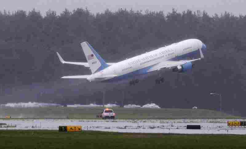 A plane carrying Kennedy's remains takes off from Hanscom Air Force base in Bedford, Mass., en route to Washington.
