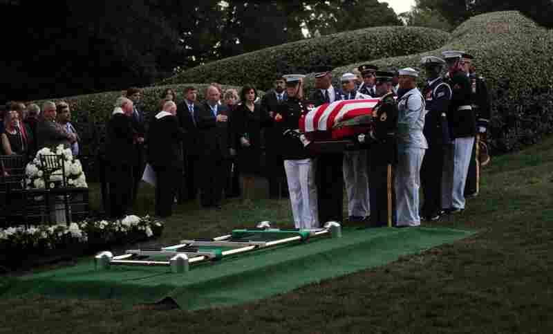 The casket of Sen. Edward Kennedy is carried by military pallbearers during his funeral at Arlington National Cemetery on Saturday. Kennedy was buried near his brothers, President John F. Kennedy and Sen. Robert Kennedy.