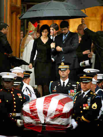 Kennedy's wife, Victoria Kennedy, follows her husband's casket out of the funeral Mass.