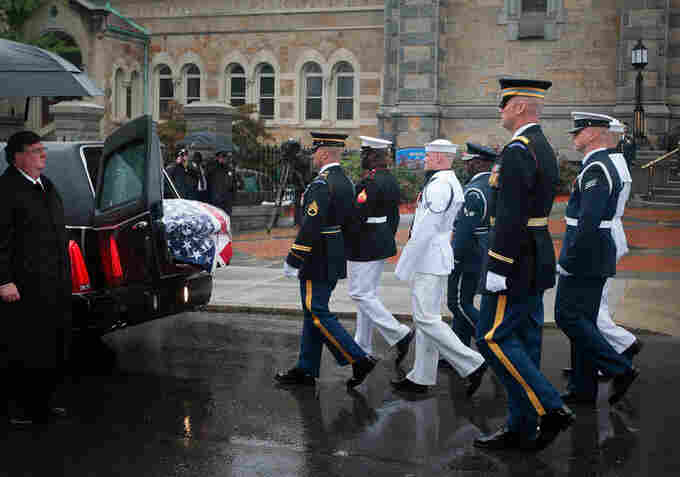 The honor guard approaches the hearse carrying Kennedy's casket outside of the funeral.