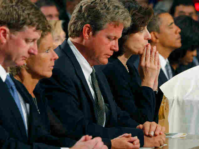 Edward Kennedy Jr. and Victoria Kennedy, center, listen during the funeral Mass for Sen. Edward Kennedy in Boston.
