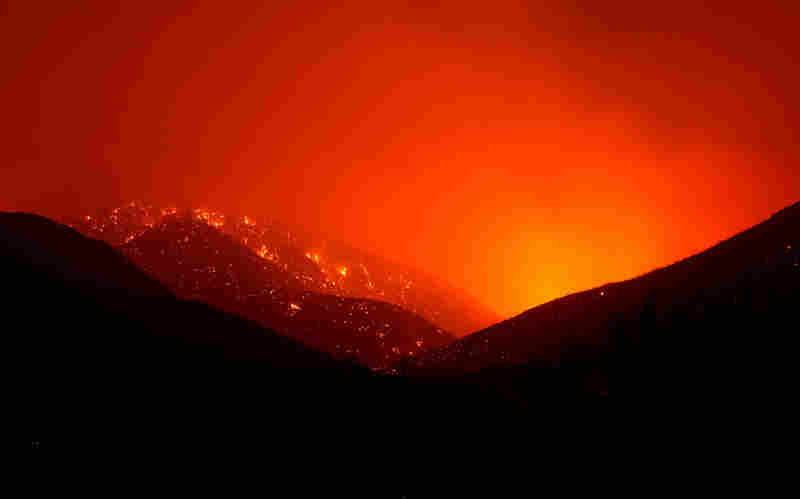 Spot fires glow in Acton on Sunday.