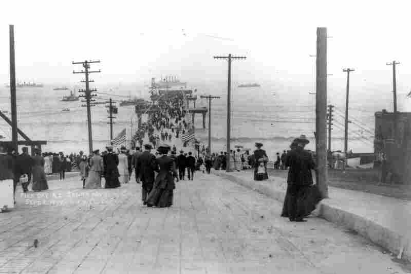 Visitors walk on the pier on opening day, Sept. 9, 1909.