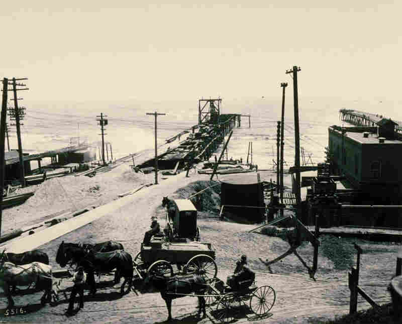 Originally, the pier was built as a public utility service that would carry sewage out to sea. Construction, shown here in 1908, took 16 months to complete.