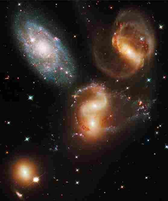 "NASA's title for this image — ""Galactic Wreckage in Stephan's Quintet"" — could easily be one of the best photographic titles ever. The image, taken in visible and near-infrared light, showcases the WFC3's broad wavelength range."