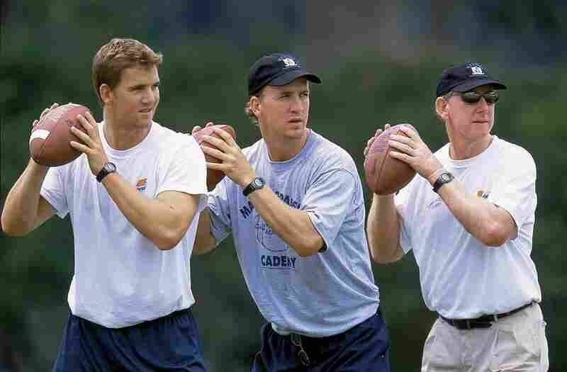 Three star QBs: Eli (left) and Peyton Manning drop back for a pass alongside their father, Archie.