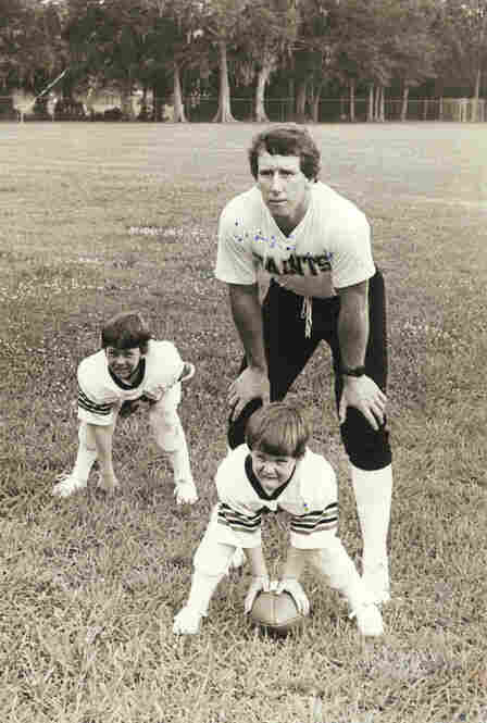 The New Orleans years: The Manning boys started playing football at a young age. Here, Cooper, 5, lines up at center as Peyton, 3, drops next to father Archie.