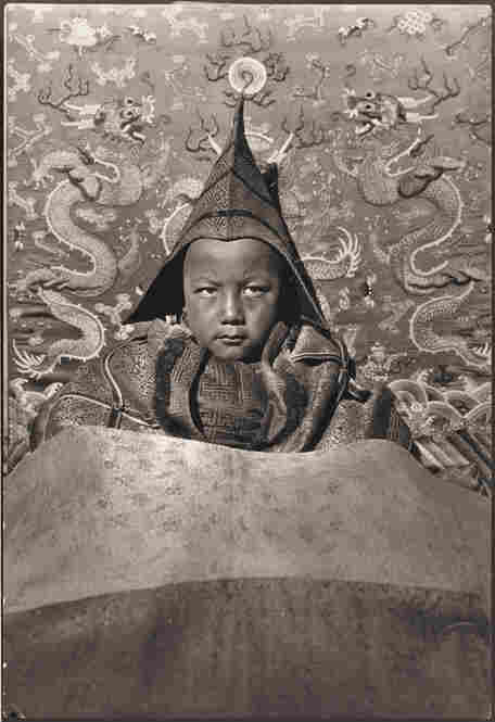 Tsemoling, The Boy God of Choni, Tibet. A farmer's son was declared by the Dalai Lama to be the reincarnation of the Tibetan king. This photograph was published in the November 1928 issue of National Geographic magazine.