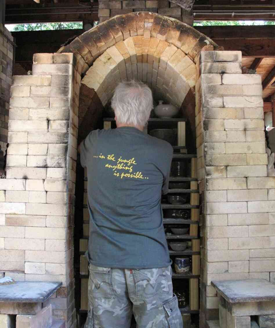 Jeff Kirk, Glen Echo's pottery guru and chief instructor, unloads the kiln.