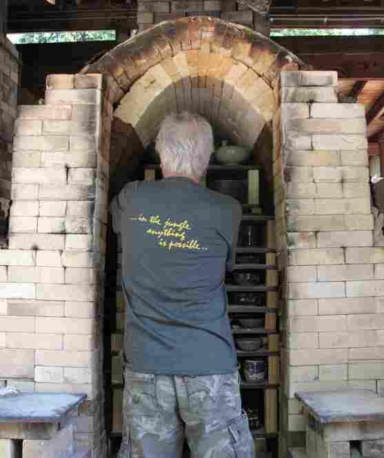 Jeff Kirk, Glen Echo's pottery guru and chief instructor, unloads the kiln.
