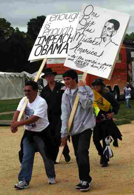 Many signs called for the impeachment of President Obama.