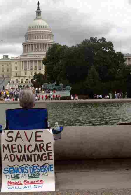 """A protestor wants to """"save"""" Medicare Advantage, which is a privately run version of the government-run program for the elderly."""