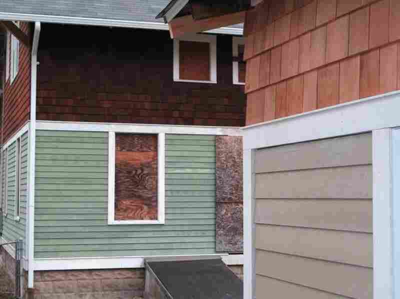 One of the other outside projects was refinshing the outside of the house with new cedar shingles.