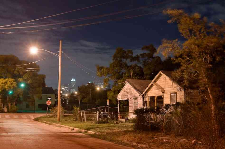 In recent years, developers and activists have battled over gentrifying and preserving the historic Third Ward. Here, the Houston skyline can be seen from a row of shotgun houses on the north end of the Third Ward.
