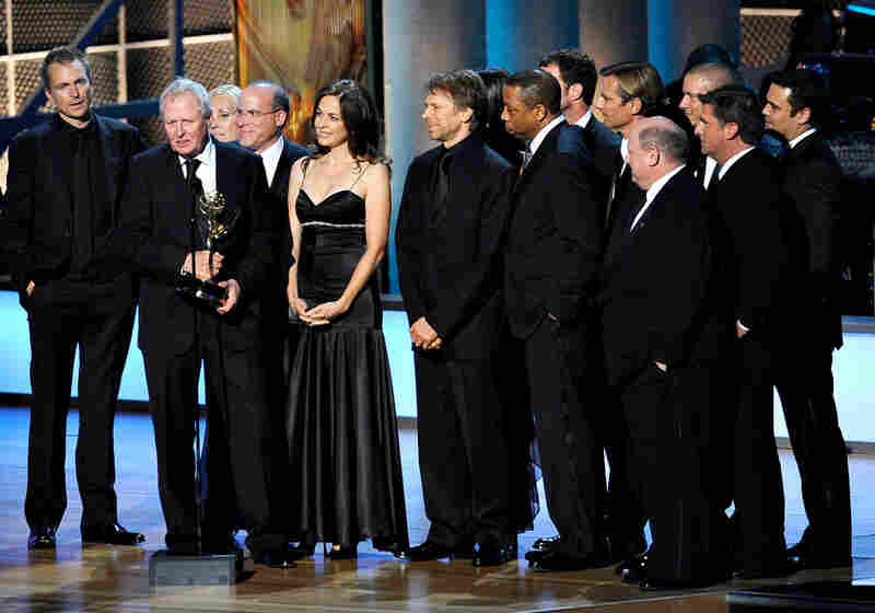 The cast and crew of The Amazing Race, co-produced by Jerry Bruckheimer, accept the Emmy for best reality competition program.