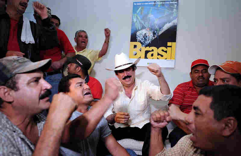 Relatives and supporters of Zelaya surround him inside the Brazilian Embassy on Wednesday.