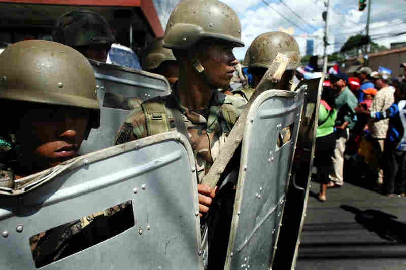 The Honduran military maintains a strong presence during protests held by Zelaya supporters in Tegucigalpa.