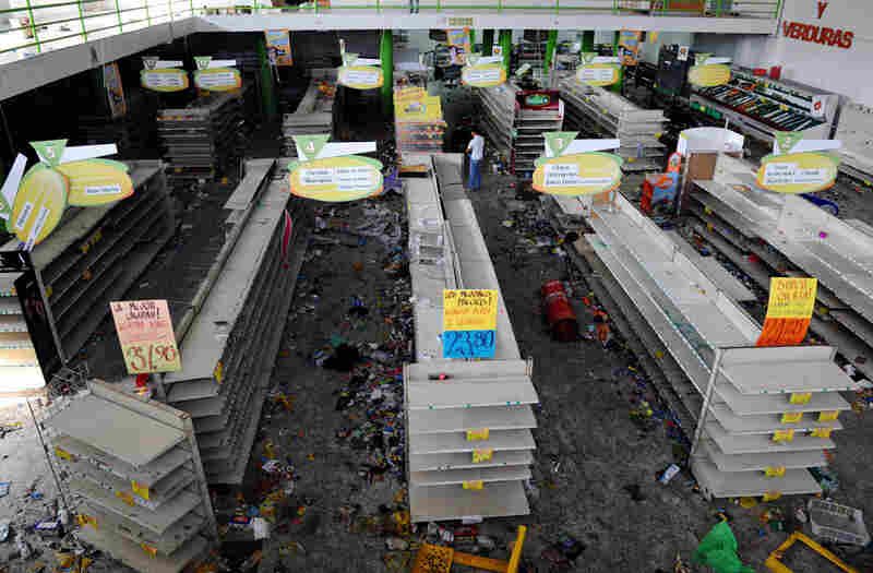 Police reported that at least one supermarket was looted during protests Wednesday in the El Pedragal neighborhood of Tegucigalpa.