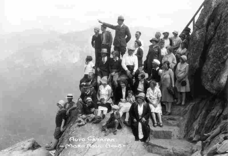 In the 1930s, a group of tourists listens to Superintendent John White at Moro Rock in Sequoia National Park. White was in charge of the park for more than a quarter century.