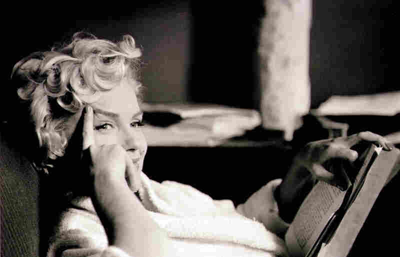 Erwitt rarely staged photographs. This image shows Monroe at ease in her home.
