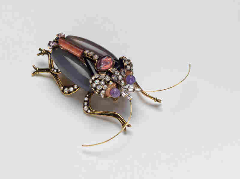 Bug, Iradj Moini (USA), 1997 - In 1999, it came to light that the Russians had bugged the U.S. State Department.  The next time Albright met with the Russians, she pinned this giant bug to her left shoulder.
