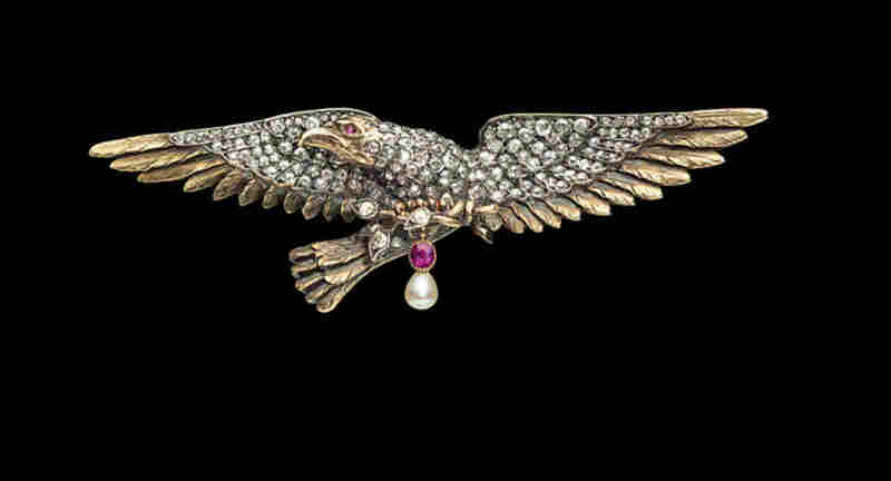 "Secretary of State Diamond Eagle, Designer Unknown (France), c. 1890 - This pin almost caused some embarrassment for Albright.  She wore it to her swearing-in ceremony as secretary of state.  Because it had a complicated clasp, she failed to fasten it properly and, during the ceremony, she looked down to see it dangling from her shoulder.  Said Albright, ""I was afraid it would fall on th..."
