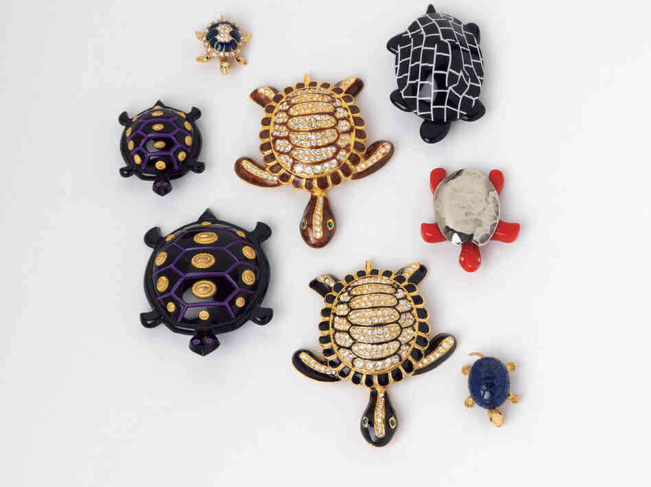 Black and White Turtle, Lea Stein (France), 1990; Small Purple, Black and Gold Turtle, Isabel Canovas (France), c. 1980; Black and Brown Rhinestone Turtles, Designer Unknown (USA), 1997; Blue Rhinestone Turtle, Designer Unknown (USA), c. 1998; Red Turtle, Designer Unknown (USA), c. 1997 - Turtle pins were used to signify the slow progress of the Middle East peace process.