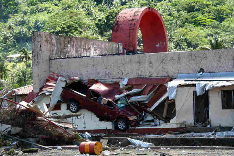 A truck lies inside a damaged building in Pago Pago village, American Samoa.