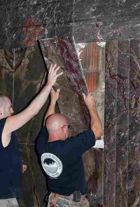 Masons install marble as part of the lobby restoration. The marble used in the renovations comes from local and international sources, including Italy and New Jersey.