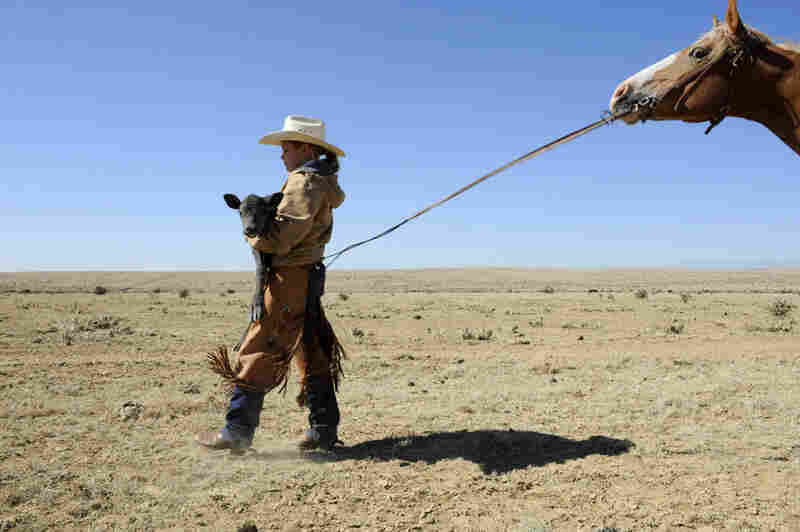 Grace Phillips, a young rancher, works out on the range of the Chico Basin Ranch in El Paso County, Colo.
